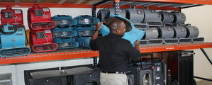 Water-Damage-Restoration-Technician-Mobilizing-Air-Movers