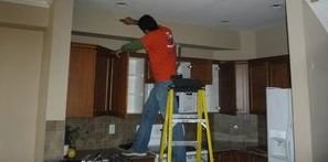 Water Damage West Warwick Technician Performing Ceiling Repair
