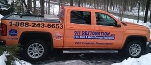 Water and Mold Damage Restoration Truck On Driveway In Winter
